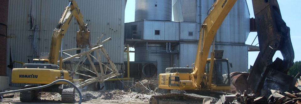 excavators demolishing structure