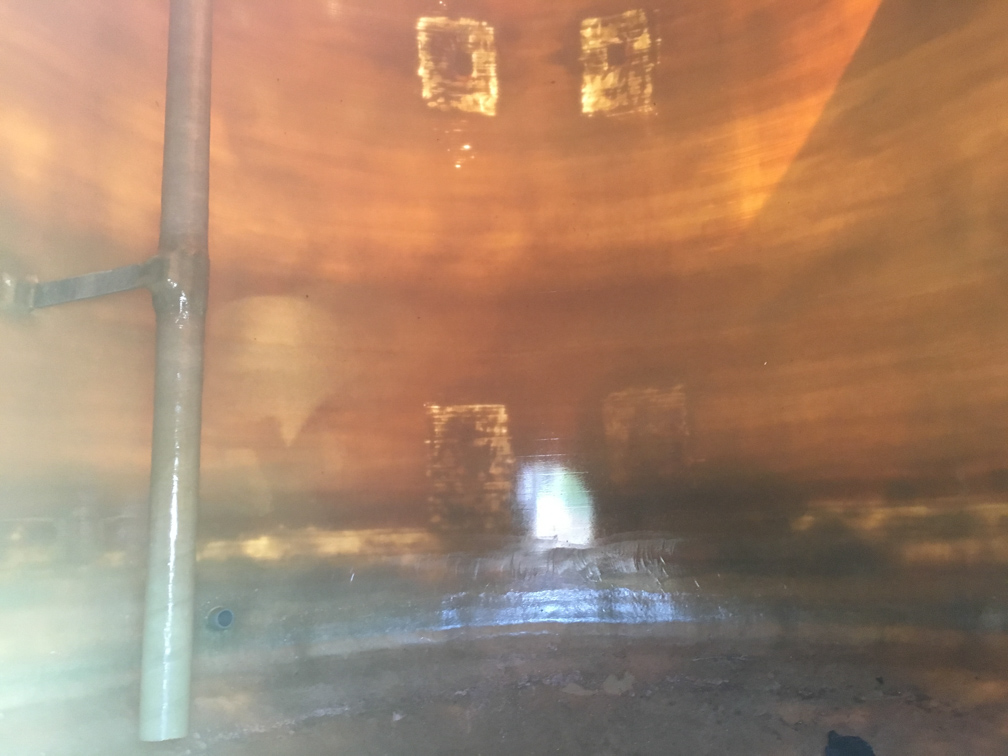 Used approximately 7,800 gallon vertical fiberglass tank