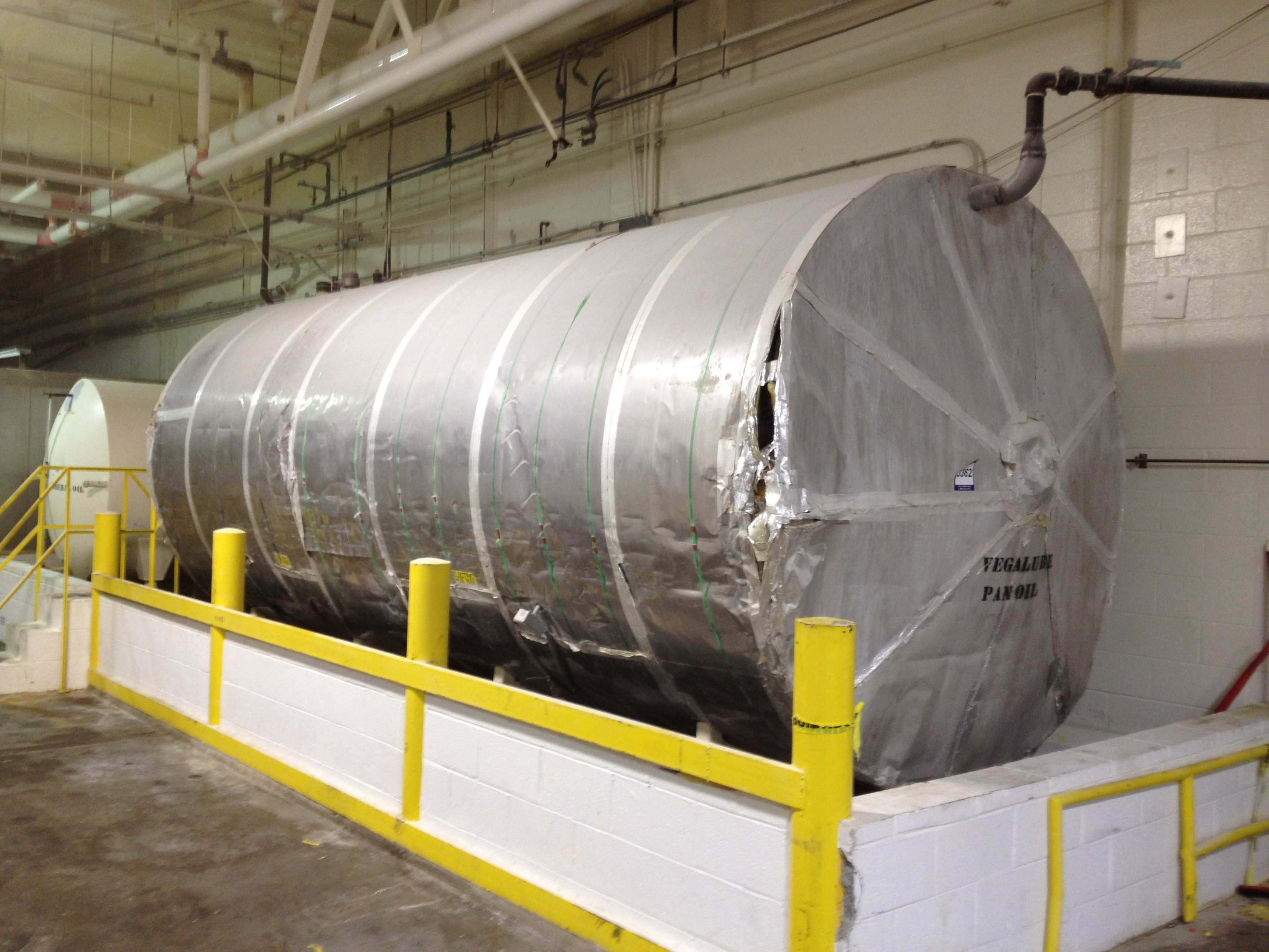 Used approximately 6000 gallon horizontal S/S tank