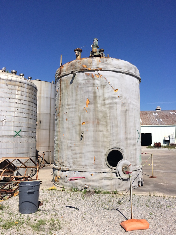 Used approximately 12,000 gallon stainless steel vertical mix tank(SOLD)