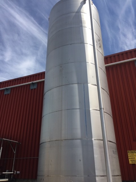 Used approximately 30,000 gallon 304 stainless steel vertical tank