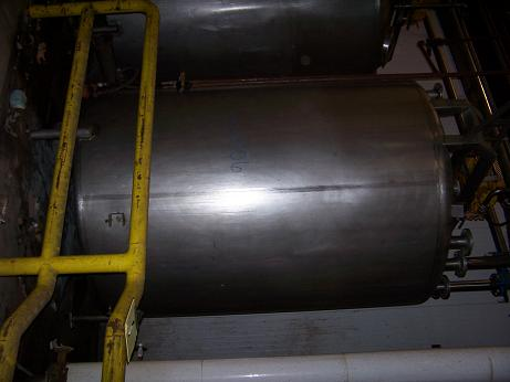 Used approximately 3000 gallon stainless steel vertical storage tank.
