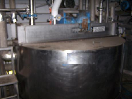 Used approximately 3000 gallon S/S vertical cold-walled jacketed mix tank