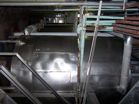 Used approximately 3000 gallon stainless steel vertical cold-walled tank.