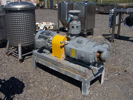 Used Nash TC-5 two-stage carbon steel vacuum pump.