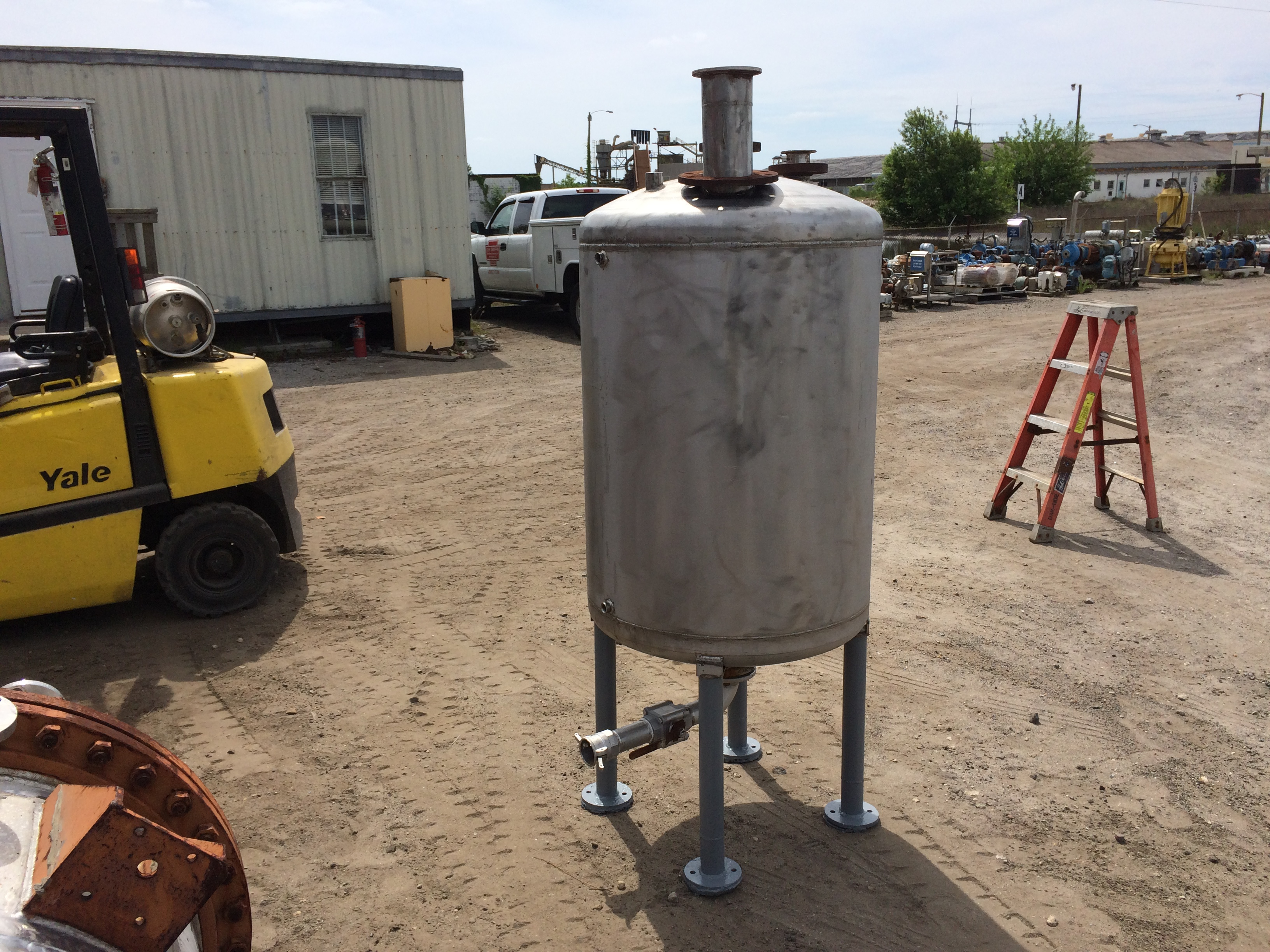 Used approximately 100 gallon stainless steel vertical tank