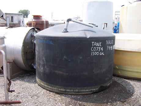 Used Approximately 1500 gallon vertical Black Poly tank