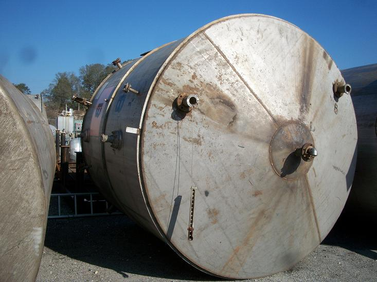 Used approximately 5500 gallon  stainless steel vertical storage tank