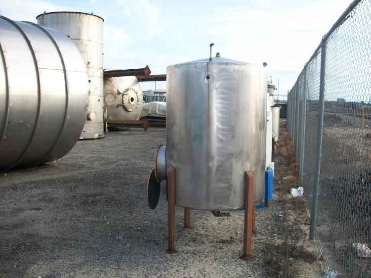 Used approximately 450 gallon 304 stainless steel vertical storage tank
