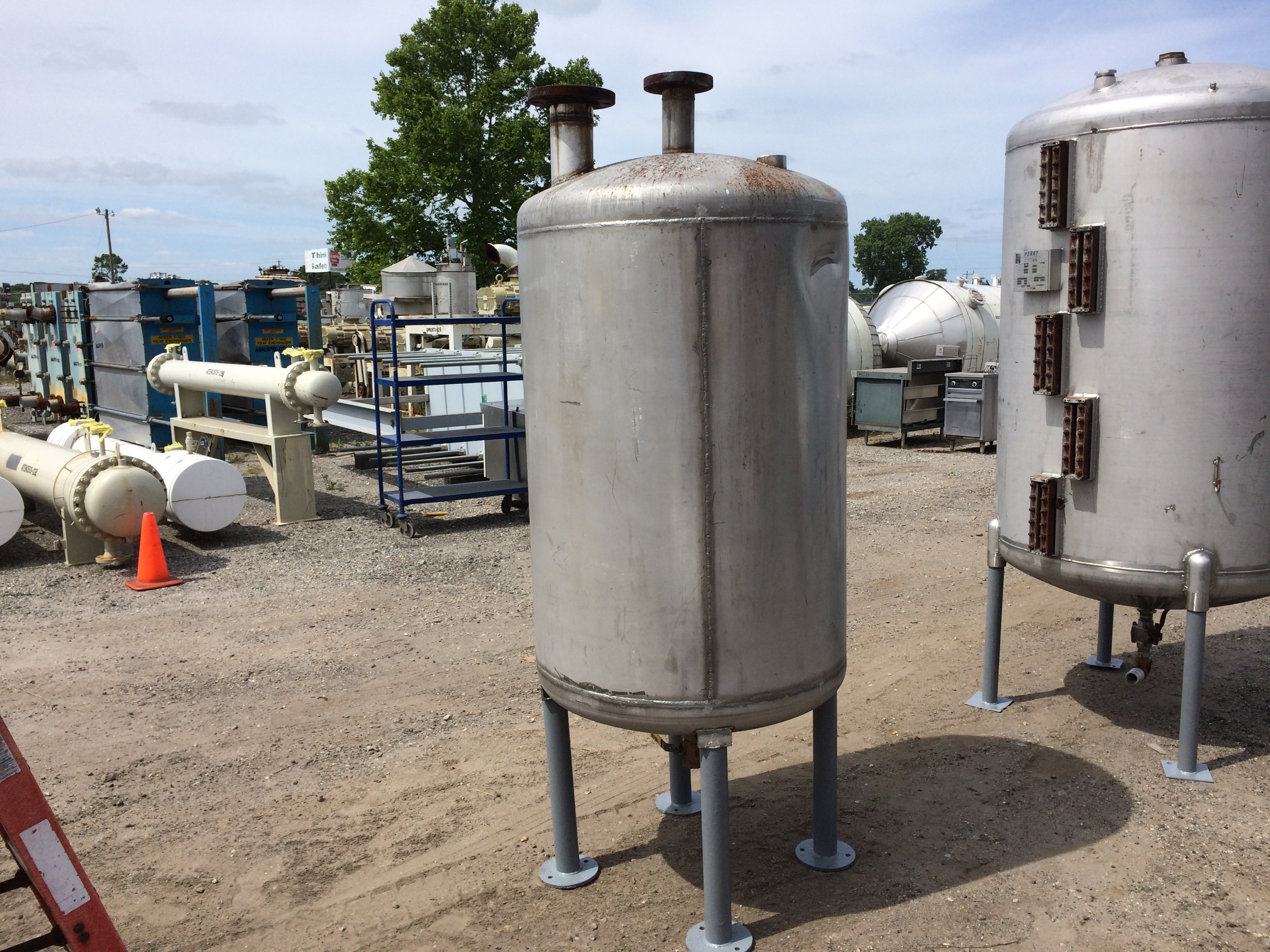 Used approximately 200 gallon stainless steel vertical tank