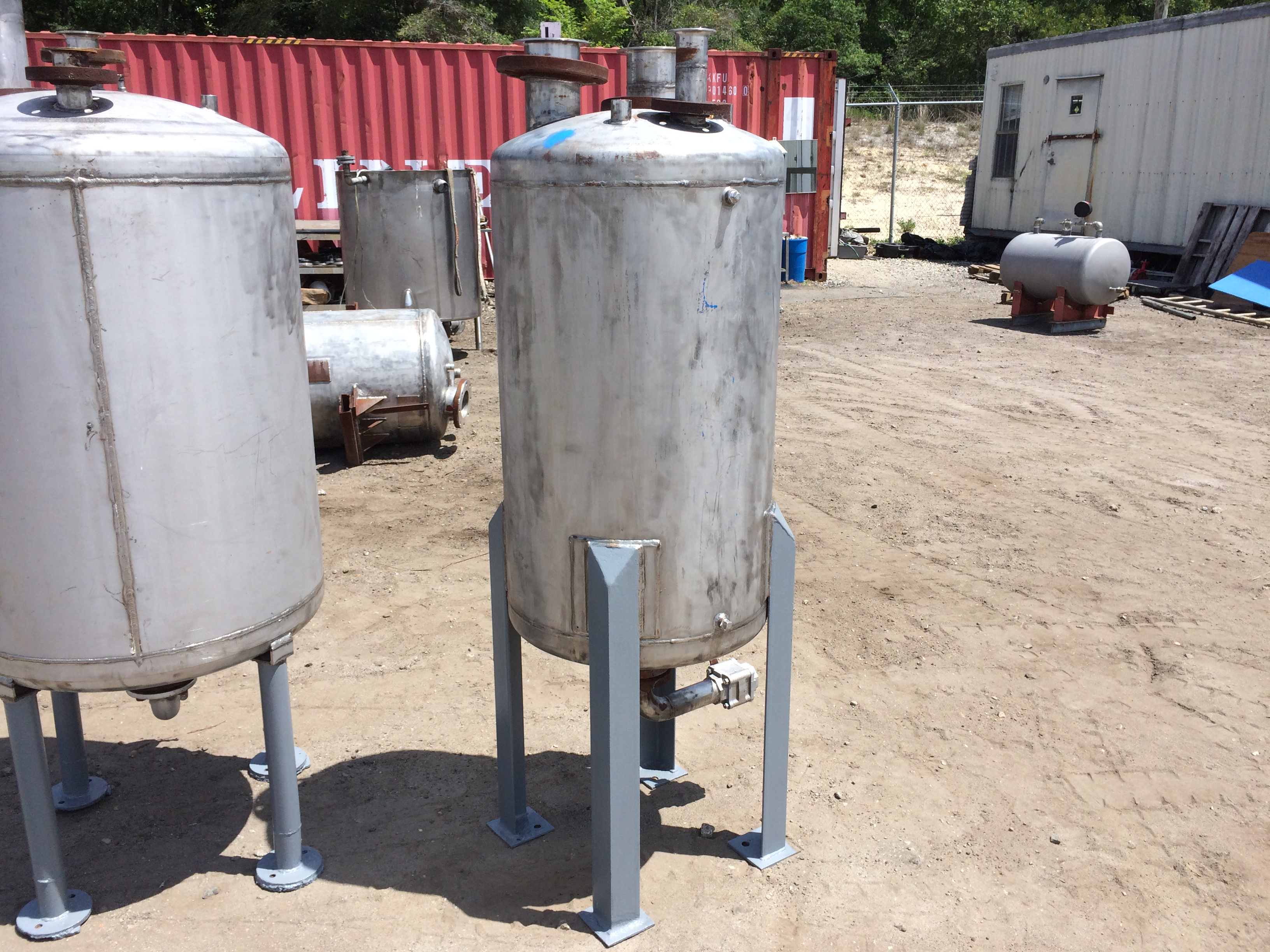 Used approximately 60 gallon stainless steel vertical tank