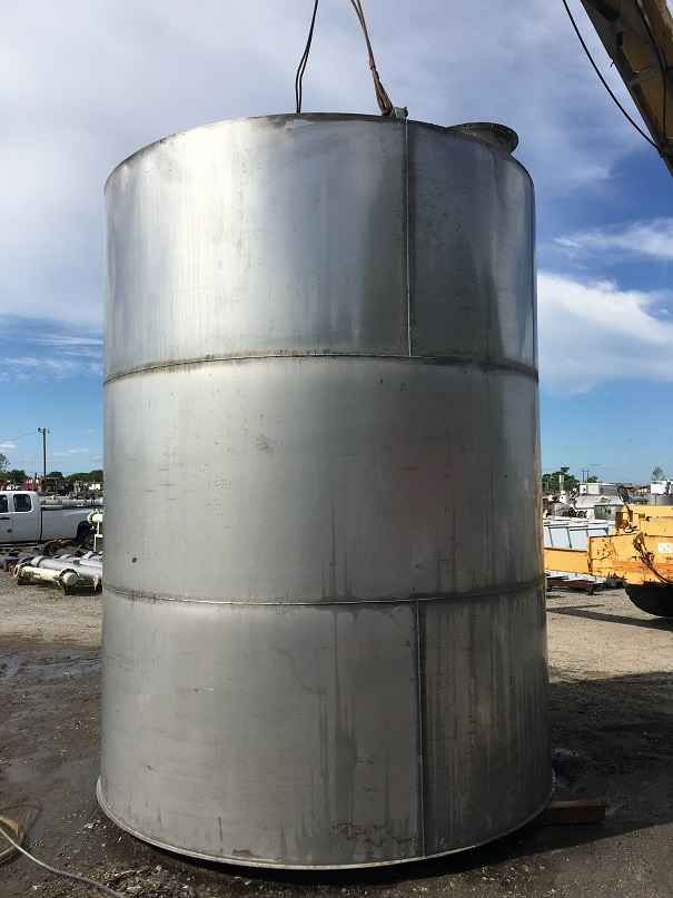Used approximately 6000 gallon 304 stainless steel vertical storage tank.